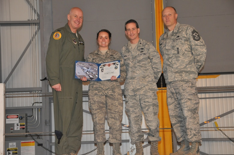 120th Operations Group Senior Airman Regina Fragale accepts her award as Safety Wingman of the Year after putting her Self-Aid Buddy care skills to use during C-130 Hercules in-flight emergency in the summer of 2014. (Montana Air National Guard photo/Staff Sgt. Lindsey Soulsby)
