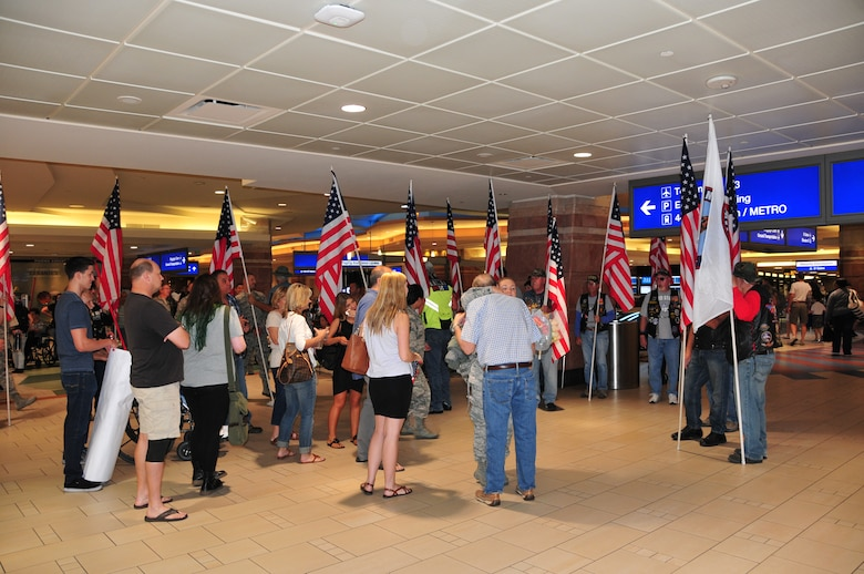 Airman 1st Class Madison Green is welcomed home by her family and the Freedom Riders at Phoenix Sky Harbor International Airport, May 2, 2015.  Seventeen members from the 161st Security Forces Squadron returned home after spending six months deployed to Southwest Asia.  (U. S. Air National Guard photo by Master Sgt. Kelly M. Deitloff)