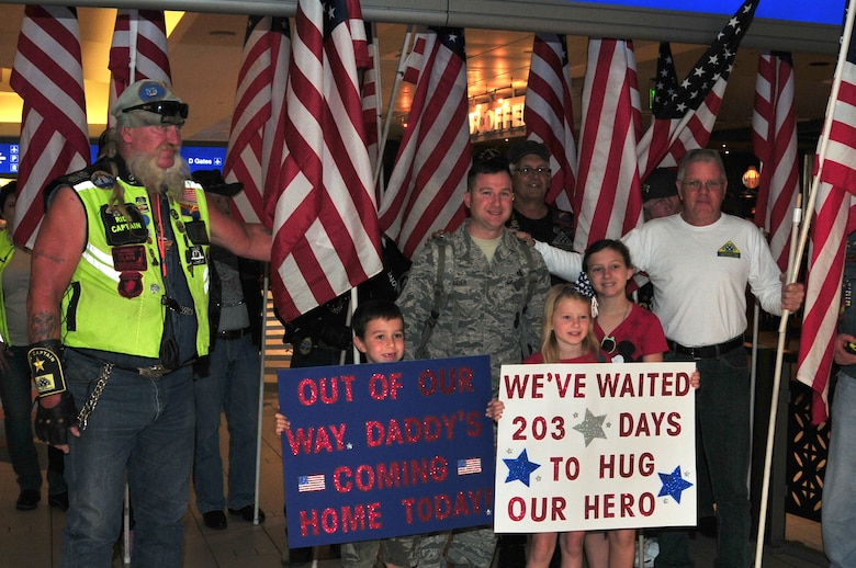 Master Sgt. Matthew Bauer is welcomed home by his family and the Freedom Riders at Phoenix Sky Harbor International Airport, May 2, 2015.  Seventeen members from the 161st Security Forces Squadron returned home after spending six months deployed to Southwest Asia.  (U. S. Air National Guard photo by Master Sgt. Kelly M. Deitloff))