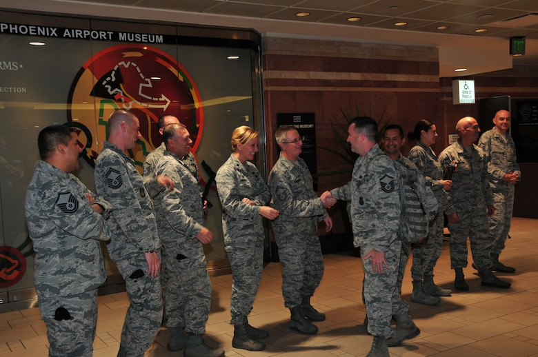 Master Sgt. Matthew Bauer is welcomed home by 161st Air Refueling Wing leadership at Phoenix Sky Harbor International Airport, May 2, 2015.  Seventeen members from the 161st Security Forces Squadron returned home after spending six months deployed to Southwest Asia.  (U. S. Air National Guard photo by Master Sgt. Kelly M. Deitloff)