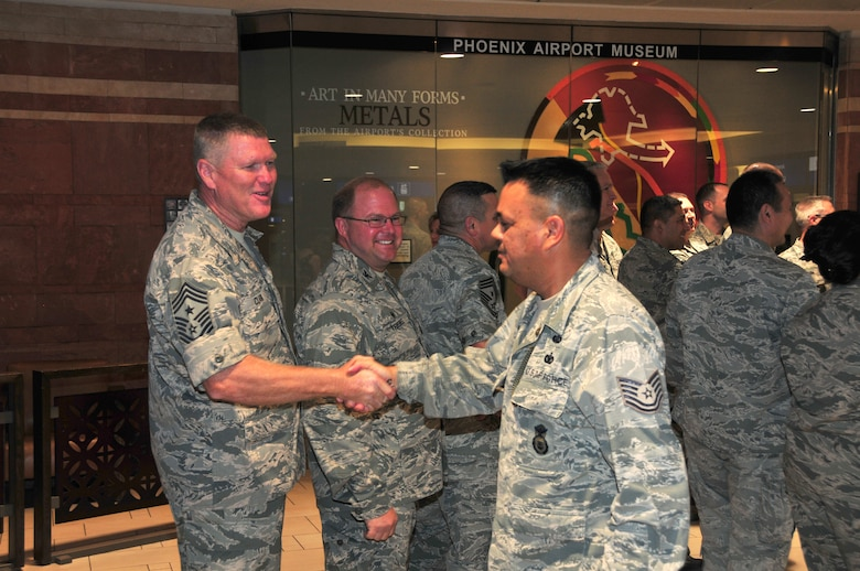 Chief Master Sgt. Shane Clark, senior enlisted advisor, Arizona National Guard, welcomes home Tech. Sgt. Lonnie Noah at Phoenix Sky Harbor International Airport, May 2, 2015.  Seventeen members from the 161st Security Forces Squadron returned home after spending six months deployed to Southwest Asia.  (U. S. Air National Guard photo by Master Sgt. Kelly M. Deitloff)