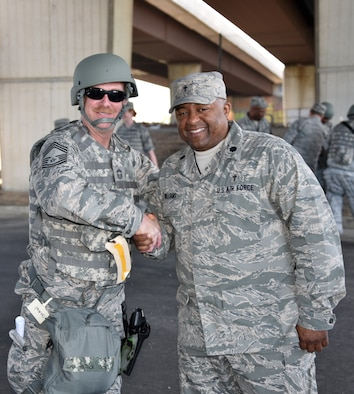 Chief Master Sgt. Patrick Shaw, left, shakes hands with Lt. Col. Ivan Williams, 175th Wing chaplain on May 2.. Shaw is part of Operation Baltimore Rally who are in Baltimore during the state of emergency. (U.S. National Guard photo by  Senior Master Sgt. Ed Bard/RELEASED)