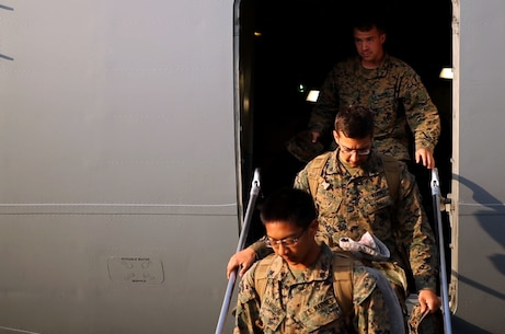 U.S. Marines, Lance Cpl. Jacob A. Miller (top), Cpl. Garrett Gloska and Cpl. Eugene Ganiron, step off a Boeing C-17 Globemaster III onto Tribhuvan International Airport in Kathmandu, Nepal, May 3. Marines brought an UH-1N Huey, tools and equipment to support the government of Nepal. The Nepalese Government requested the U.S. Government's help after a 7.8 magnitude earthquake struck their country, April 25. The Marines are with Marine Light Attack Helicopter Squadron 469, Marine Air Group 36, I Marine Aircraft Wing, III Marine Expeditionary Force. Miller is from Hamilton, Ohio. Gloska is from Jacksonville, Florida. Ganiron is from. (U.S. Marine Corps photo by Lance Cpl. Mandaline Hatch/Released)