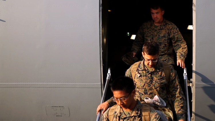 U.S. Marines, Lance Cpl. Jacob A. Miller (top), Cpl. Garrett Gloska and Cpl. Eugene Ganiron, step off a Boeing C-17 Globemaster III onto Tribhuvan International Airport in Kathmandu, Nepal, May 3. Marines brought an UH-1N Huey, tools and equipment to support the government of Nepal. The Nepalese Government requested the U.S. Government's help after a 7.8 magnitude earthquake struck their country, April 25. The Marines are with Marine Light Attack Helicopter Squadron 469, Marine Air Group 36, I Marine Aircraft Wing, III Marine Expeditionary Force. (U.S. Marine Corps photo by Lance Cpl. Mandaline Hatch/Released)