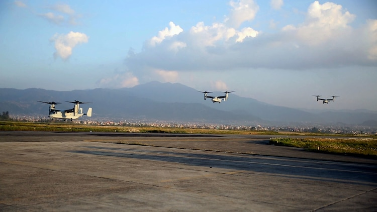 U.S. Marine V-22 Ospreys fly into Tribhuvan International Airport in Kathmandu, Nepal, May 3. U.S. Marines also brought an UH-1N Huey, tools and equipment to support the government of Nepal. The Nepalese Government requested the U.S. Government's help after a 7.8 magnitude earthquake struck their country, April 25. The aircraft are with Marine Medium Tiltrotor Squadron 262, Marine Aircraft Group 36, 1st Marine Aircraft Wing, III Marine Expeditionary Force. (U.S. Marine Corps photo by Lance Cpl. Mandaline Hatch/Released)