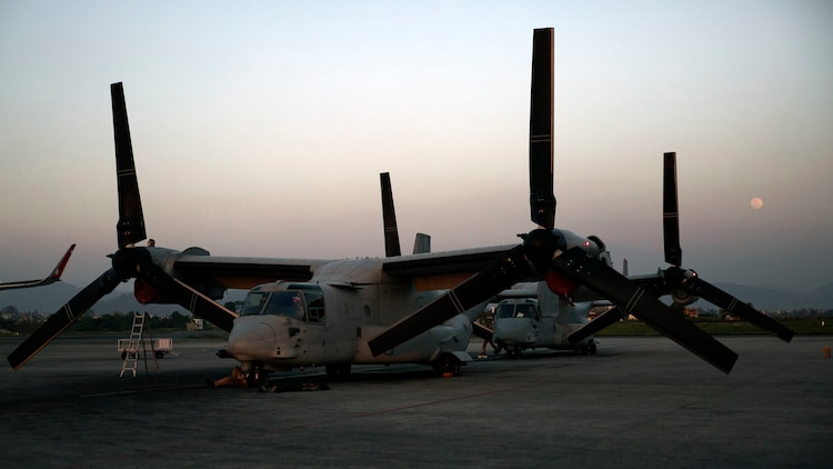 U.S. Marine V-22 Ospreys arrive at Tribhuvan International Airport in Kathmandu, Nepal, May 3. U.S. Marines also brought an UH-1N Huey, tools and equipment to support the government of Nepal. The Nepalese Government requested the U.S. Government's help after a 7.8 magnitude earthquake struck their country, April 25. The aircraft are with Marine Medium Tiltrotor Squadron 262, Marine Aircraft Group 36, 1st Marine Aircraft Wing, III Marine Expeditionary Force. (U.S. Marine Corps photo by Lance Cpl. Mandaline Hatch/Released)