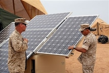 U.S. Marines testing a new environmentally-friendly energy system which will enable deployed troops to purify water, light their tents and power their equipment through solar energy and leverage technology.