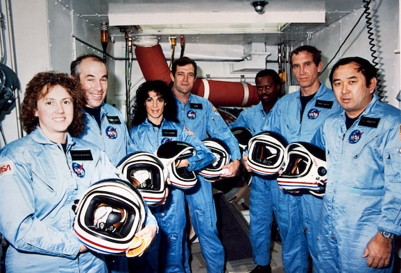 "STS-51L crew members pose during a break in countdown training in the White Room at Launch Pad 39B in November of 1985. From the left are Christa McAuliffe, Gregory Jarvis, Judith Resnik, Francis ""Dick"" Scobee, Ronald McNair, Mike Smith and Ellison Onizuka. (Courtesy photo/NASA)"
