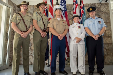 "Left to right: Lieutenant Luke Morgan, Alpha Troop Commander, 1st Transport Squadron, 1st Combat Service Support Battalion; Lt. Stephen Weir, operations officer with 105 Signal Squadron, 1st Combat Signal Regiment; Sgt. Bradley S. Minge, color sergeant with Headquarters and Support Company, 1st Battalion, 4th Marine Regiment, Marine Rotational Force - Darwin; Lt. Katherine Newson, maritime logistics officer with Headquarters Northern Command, Joint Operations Command - Australian Theatre;  Flight Lieutenant Heath Fulton, operations officer with Joint Task Force 639 ACCE, Royal Australian Air Force Base Darwin, Darwin, Australia. The service members stand before the new location for the national and ensign flags during a ceremony to mark the relocation of service flags April 26 at the Darwin Memorial United Church, Darwin, Australia. The service of worship and ceremony was held in order to relocate the flags to the foyer to create more room for the ""Fujita"" Peace and Reconciliation Exhibition. Events in the community allow Marines to learn about the history the U.S. and Australia share, and to further the longstanding relationship between the U.S. and Australia."