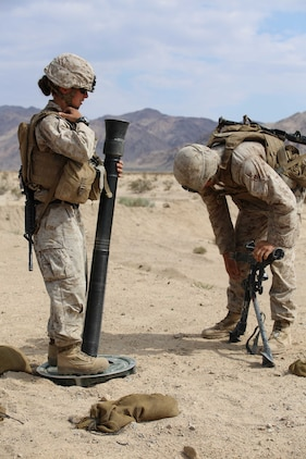 Sgt. Dustin Houghton, right, and Cpl. Jacklyn Dean, left, both mortar men with Mortar Platoon, Weapons Company, Ground Combat Element Integrated Task Force, secure an M252 81mm medium-weight mortar during a Marine Corps Operational Test and Evaluation Activity assessment at Range 107, Marine Corps Air Ground Combat Center Twentynine Palms, California, April 24, 2015. From October 2014 to July 2015, the GCEITF will conduct individual and collective level skills training in designated ground combat arms occupational specialties in order to facilitate the standards-based assessment of the physical performance of Marines in a simulated operating environment performing specific ground combat arms tasks. (U.S. Marine Corps photo by Cpl. Paul S. Martinez/Released)