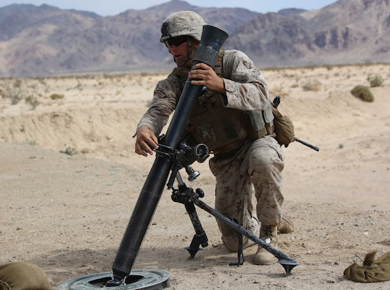 Sgt. Dustin Houghton, mortar man, Mortar Platoon, Weapons Company, Ground Combat Element Integrated Task Force, secures an M252 81mm medium-weight mortar during a Marine Corps Operational Test and Evaluation Activity assessment at Range 107, Marine Corps Air Ground Combat Center Twentynine Palms, California, April 24, 2015. From October 2014 to July 2015, the GCEITF will conduct individual and collective level skills training in designated ground combat arms occupational specialties in order to facilitate the standards-based assessment of the physical performance of Marines in a simulated operating environment performing specific ground combat arms tasks. (U.S. Marine Corps photo by Cpl. Paul S. Martinez/Released)