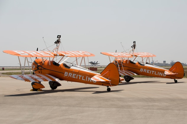 Two Boeing Stearman aircraft with the Breitling Wingwalkers sit at the flightline aboard Marine Corps Air Station Iwakuni, Japan, May 1, 2015. The Breitling Wingwalkers are slated to perform during the Japan Maritime Self-Defense Force/MCAS Iwakuni Friendship Day 2015 Air Show, May 3, 2015. This year the event expanded to combine both the JMSDF's Fleet Air Wing 31's annual Open House and the traditional MCAS Iwakuni Friendship Day, resulting in the first-ever joint Friendship Day air show. The event allows visitors a chance to see the military installation and interact with Japanese and American service members while enjoying aerial performances and static displays.