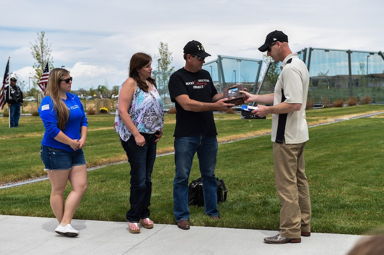 The family of Cpl. David Sonka are presented a custom bible from Fallen Heroes Honored May 2, 2015, at the Colorado Freedom Memorial in Aurora, Colo. The weekend's events were held to honor the life of Sonka, a U.S. Marine Corps Military Working Dog handler who was killed in action in Afghanistan May 4, 2013. The weekend's events included a motorcade to his grave, two memorial services, the reading of the names of all MWD and MWD handlers killed in action during Vietnam and recent years, a BBQ, and concluded with a multi-service dog handling competition. (U.S. Air Force photo by Senior Airman Phillip Houk/Released)