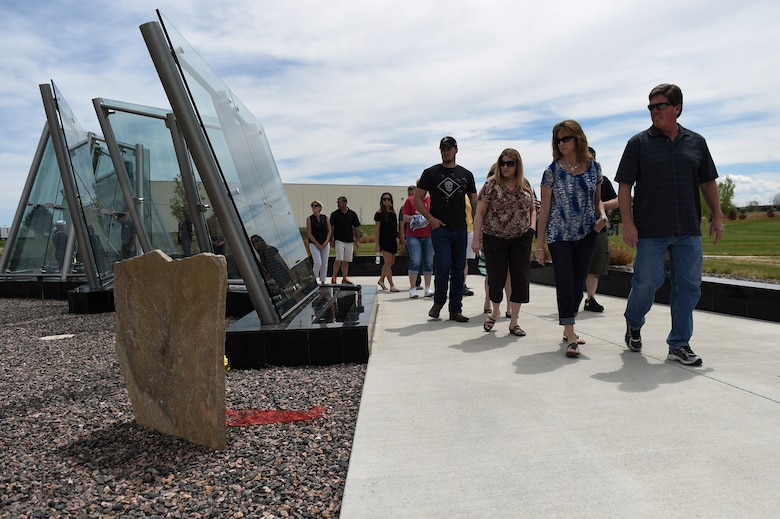 Family members and friends gather at Cpl. David Sonka's Memorial Service May 2, 2015, at the Colorado Freedom Memorial in Aurora, Colo. The weekend's events were held to honor the life of Sonka, a U.S. Marine Corps Military Working Dog handler who was killed in action in Afghanistan May 4, 2013. The weekend's events included a motorcade to his grave, two memorial services, the reading of the names of all MWD and MWD handlers killed in action during Vietnam and recent years, a BBQ, and concluded with a multi-service dog handling competition. (U.S. Air Force photo by Senior Airman Phillip Houk/Released)