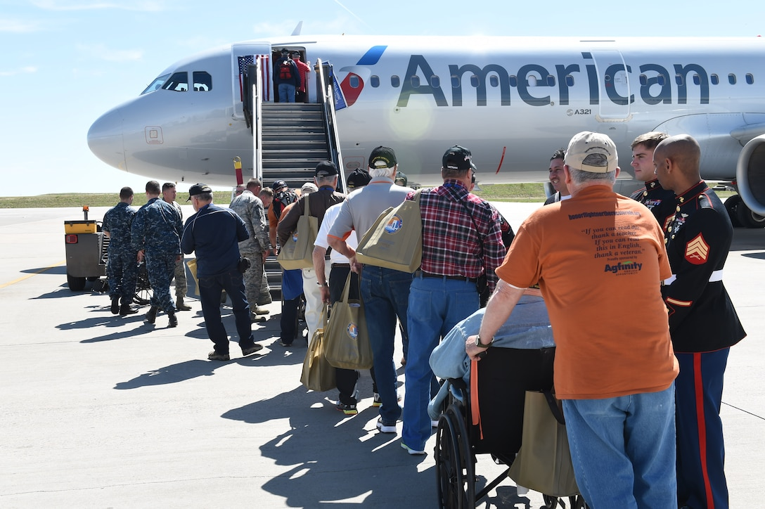 World War II, Vietnam and Korea veterans, along with terminally ill and Purple Heart recipient veterans, board a plane May 3, 2015, at Denver International Airport in Denver. Hosted by the Honor Flight of Northern Colorado, the overnight trip to Washington D.C. gave veterans the chance to visit military memorials. The trip is offered every year free of charge for the vets through donations from the public. (U.S. Air Force photo Airman 1st Class Samantha Meadors/Released)