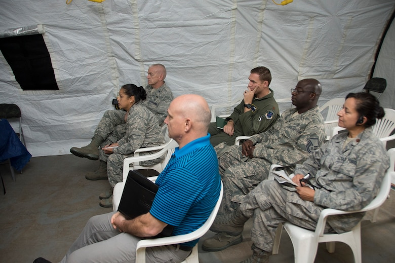 Members in support of Air Forces Southern receive a brief from members of the Brazilian air force during an Expeditionary Medical Support training site visit on April 22, 2015, in Rio de Janeiro, Brazil. During the site visit,  members of AFSOUTH assed the location chosen to place the EMEDS as well as checked to make sure all components of the EMEDS were properly installed. (U.S. Air Force photo by Staff Sgt. Adam Grant/Released)