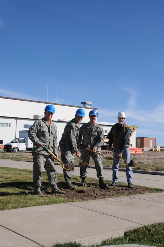 Lt. Col. Buel Dickson, 120th Maintenance Group commander; Col. J. Peter Hronek, 120th Airlift Wing commander; Lt. Col. Frederyck Cayer,120th Civil Engineer commander and John Engebretsen, James Talcott Construction project manager, break ground at the C-130 consolidated maintenance hangar construction site at the 120th Airlift Wing Oct. 17.  Construction of the hangar is expected to take one year. (Montana Air National Guard photo/Maj. Cody Smith)