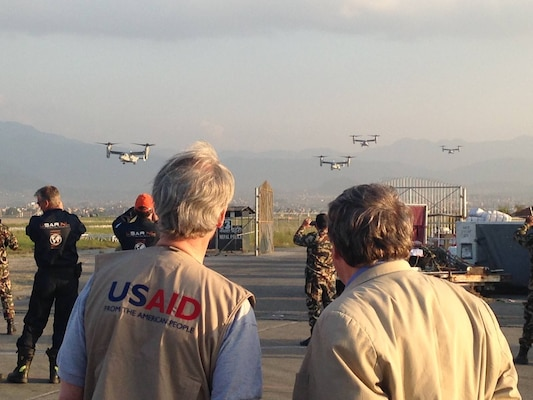 U.S. Marine Corps MV-22B Ospreys arrive at Tribhuvan International Airport in Kathmandu, Nepal, May 3. The Marines also brought a UH-1Y Huey, tools and equipment in response to the Nepalese government's request for assistance after a magnitude 7.8 earthquake April 25. The aircraft are with Marine Medium Tiltotor Squadron 262, Marine Aircraft Group 36, 1st Marine Aircraft Wing, III Marine Expeditionary Force. Courtesy photo by Natalie Hawwa, USAID/OFDA