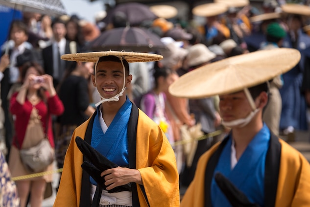 Lance Cpl. Carlos Cruz Jr., a combat correspondent with the Public Affairs Office aboard Marine Corps Air Station Iwakuni, Japan, walks in the Daimyo Procession during the 38th Annual Kintai-kyo Bridge Festival, in Iwakuni City, April 29, 2015. The procession is an annual parade that reenacts the return of a daimyo, one of the most powerful feudal rulers who is subordinate only to the shogun and his entourage from the capital of Japan.