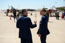 Col. Brian Hastings, 47th Flying Training Wing commander, left, speaks with Brig. Gen. Scott Pleus, 56th Fighter Wing commander, at Laughlin Air Force Base, Texas, May 1, 2015. The 56th FW is the largest fighter wing in the U.S. Air Force, graduating more than 300 F-16 pilots and 300 air control professionals annually, and will soon transition into the sole pilot training center for the F-35 Lightning II.  (U.S. Air Force photo by Tech. Sgt. Steven R. Doty)