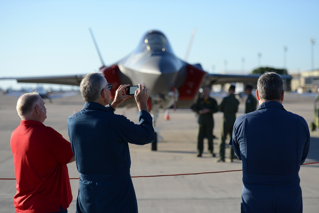 """Danny Williams, 47th Student Squadron Simulator instructor, captures images of the F-35 Lightning II sits at Laughlin Air Force Base, Texas, May 1, 2015. The two F-35's are based out of the 61st Fighter Squadron, nicknamed """"Top Dogs"""", at Luke Air Force Base, Arizona. (U.S. Air Force photo by Tech. Sgt. Steven R. Doty)"""