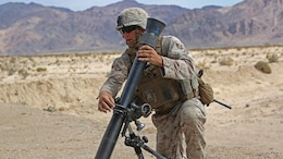 Sgt. Dustin Houghton, mortar man, with Ground Combat Element Integrated Task Force, secures an M252 81mm medium-weight mortar during a Marine Corps Operational Test and Evaluation Activity assessment at Range 107, Marine Corps Air Ground Combat Center Twentynine Palms, California, April 24, 2015. From October 2014 to July 2015, the GCEITF will conduct individual and collective level skills training in designated ground combat arms occupational specialties in order to facilitate the standards-based assessment of the physical performance of Marines in a simulated operating environment performing specific ground combat arms tasks.