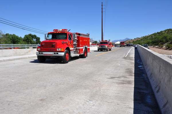 Fire and rescue vehicles from the Nogales Suburban Fire District cross the newly opened Nogales Wash Bridge April 17 in Nogales, Arizona. The U.S. Army Corps of Engineers Los Angeles District constructed the $4 million bridge after the original structure was removed in 2008 as part of a flood control construction project.