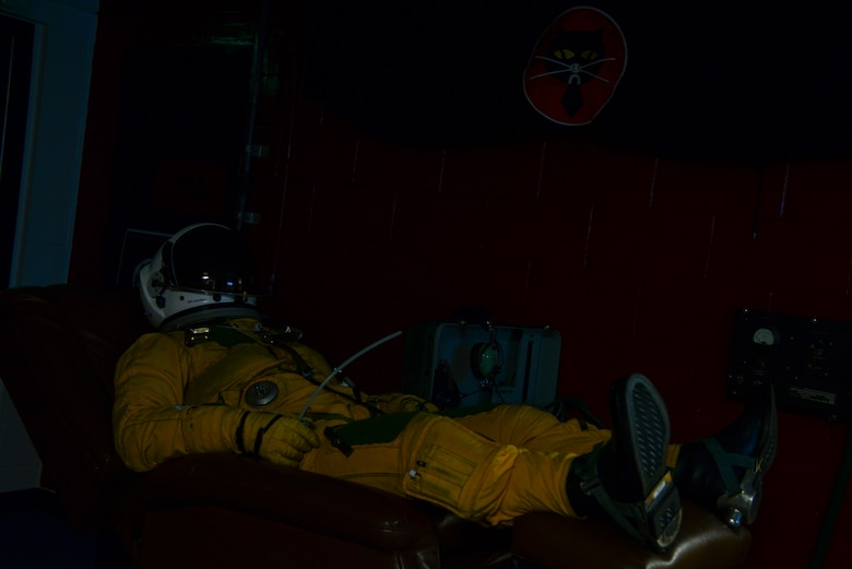 Lt. Col. Luke Lokowich, 5th Reconnaissance Squadron commander and a U-2 pilot, breathes in pure oxygen before his high-altitude flight April 22, 2015, at Osan Air Base, Republic of Korea. In preparation for a high-altitude flight U-2 pilots must intake pure oxygen for one hour before they take off for their flight. (U.S. Air Force photo by Senior Airman Matthew Lancaster)