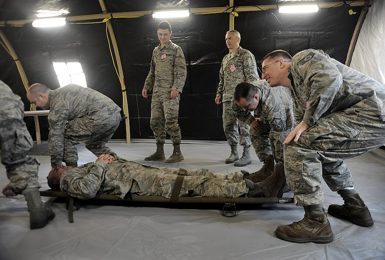 A group of Oregon Air National Guard Airmen work together at one of eight stations set up for training during the AEF Skill Rodeo, April 12, 2015, Portland Air National Guard Base, Ore. (U.S. Air National Guard photo by Tech. Sgt. John Hughel, 142nd Fighter Wing Public Affairs/Release)