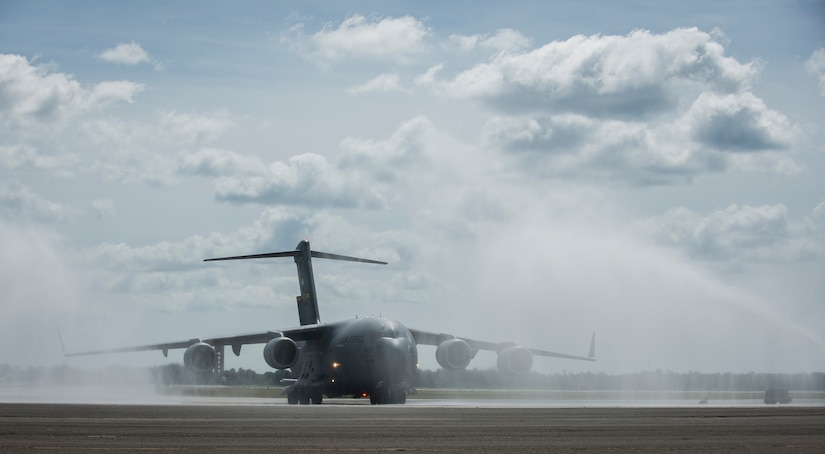 A C-17 Globemaster III assigned to the 437th Airlift Wing and the 315th Airlift Wing is sprayed with water May 5, 2015 at Joint Base Charleston, S.C., during an event celebrating the C-17 surpassing the three millionth flying hour.  Aircrew members from JB Charleston flew the plane here from Robins Air Force Base, Ga. The first C-17 flight was Sept. 15, 1991 and the Air Force currently has 222 C-17's in the fleet. (U.S. Air Force photo/Senior Airman Jared Trimarchi)