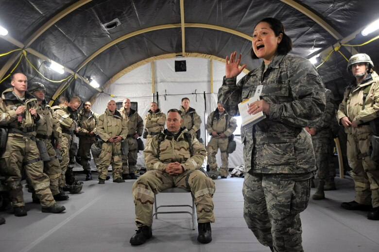 Oregon Senior Airman Crystal Atkinson, assigned to the 142nd Civil Engineer Squadron, instructs Airmen during the AEF Skills Rodeo, April 12, 2015, Portland Air National Guard Base, Ore. (U.S. Air National Guard photo by Tech. Sgt. John Hughel, 142nd Fighter Wing Public Affairs/Release)