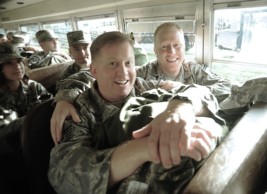 Airmen from the Oregon Air National Guard enjoy a lighter moment during the bus ride to the AEF Skill Rodeo training area, April 12, 2015, Portland Air National Guard Base, Ore. (U.S. Air National Guard photo by Tech. Sgt. John Hughel, 142nd Fighter Wing Public Affairs/Release)