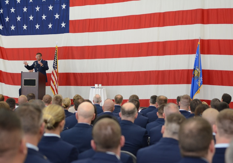Major Donald J. Heiar, 115th Fighter Wing chaplain, delivers scripture and a reflection during Airman 1st Class Kelly C. Tomfohrde's memorial service, May 3. Airmen of the 115 FW, family members and friends gathered to honor Tomfohrde's service, sacrifices and to recognize her achievements and dedication during the memorial service on base. (U.S. Air National Guard photo by Tech. Sgt. Tiffany Black)