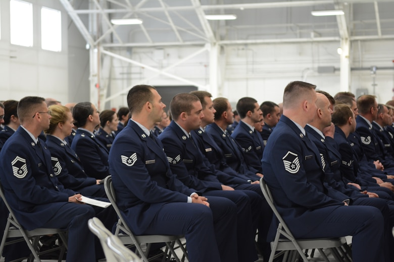 Airmen of the 115th Fighter Wing, family members and friends gathered to honor Airman 1st Class Kelly C. Tomfohrde's service, sacrifices and to recognize her achievements and dedication during the memorial service on base, May 3. (U.S. Air National Guard photo by Tech. Sgt. Tiffany Black)