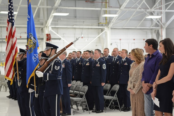The115th Fighter Wing Honor Guard posts the colors during Airman 1st Class Kelly C. Tomfohrde's memorial service, May 3. Airmen of the 115 FW, family members and friends gathered to honor Tomfohrde's service, sacrifices and to recognize her achievements and dedication during the memorial service on base. (U.S. Air National Guard photo by Tech. Sgt. Tiffany Black)