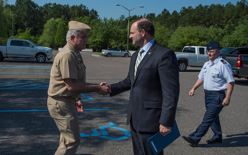 Capt. Timothy Sparks greets South Carolina Attorney General Alan Wilson during a base visit May 4, 2015 at Joint Base Charleston - Weapons Station, S.C. Wilson and Holly Petraeus, Consumer Financial Protection Bureau Senior Federal Executive Office of Servicemember Affairs, participated in a town hall meeting with Airmen and Sailors to educate them about their financial rights. Sparks is the JB Charleston deputy commander (U.S. Air Force photo/Senior Airman Jared Trimarchi)