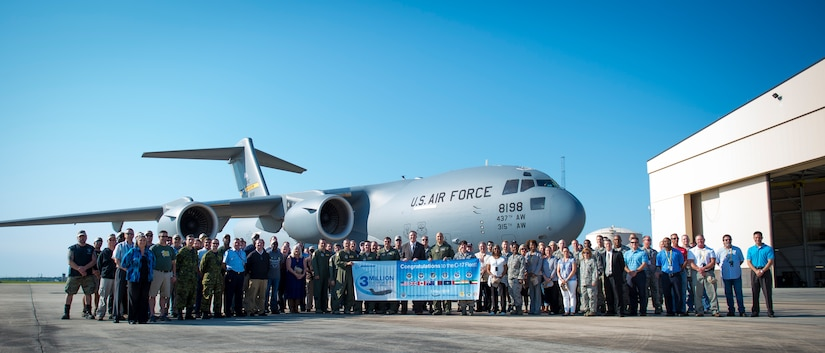 Personnel from the C-17 System Program Office, Boeing and aircrew members from the 437th Airlift Wing pose for a photo in front of a C-17 Globemaster III at Robins Air Force Base, Ga., May 5, 2015. During the flight to Joint Base Charleston, S.C., the C-17 logged the fleet's three-millionth flying hour. Upon arriving at JB Charleston, the aircraft taxied through a water arch provided by the 628th Civil Engineering Squadron's Fire Department and was met by senior leaders and JB Charleston civic leaders. (U.S. Air Force photo / Airman 1st Class Clayton Cupit)
