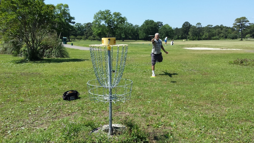 Tech. Sgt. Larry Kirk, a member of the Air National Guard's 144th Fighter Wing in Fresno, Ca., and an avid disc golf player, played the Disc Golf Course here at Joint Base Charleston, S.C., April 30, 2015. Disc golf is played much like traditional golf. Instead of a ball and clubs, however, players use a flying disc, or Frisbee®. Kirk is touring the U.S. for the fourth time attempting to play Disc Golf in 50 states in 50 days. (Courtesy photo)