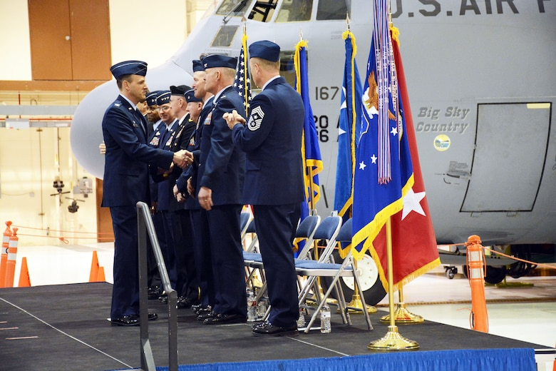 Col. Lee Smith shakes hands with Col. J. Peter Hronek at the conclusion of the 120th Airlift Wing's change of command ceremony March 7, 2015. (Montana Air National Guard photo/Senior Master Sgt. Eric Peterson)