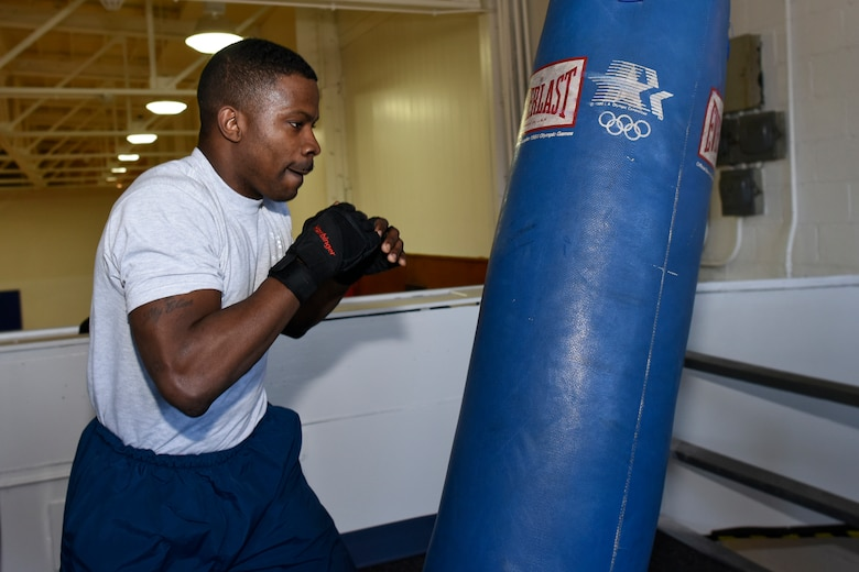 Airman 1st Class Onnie McSpadden works out with a heavy bag in the gym at Selfridge Air National Guard Base, Mich., April 28, 2015. McSpadden is a former boxer who now serves as a member of the 127th Wing, Michigan Air National Guard at Selfridge. (U.S. Air National Guard photo by Terry Atwell)