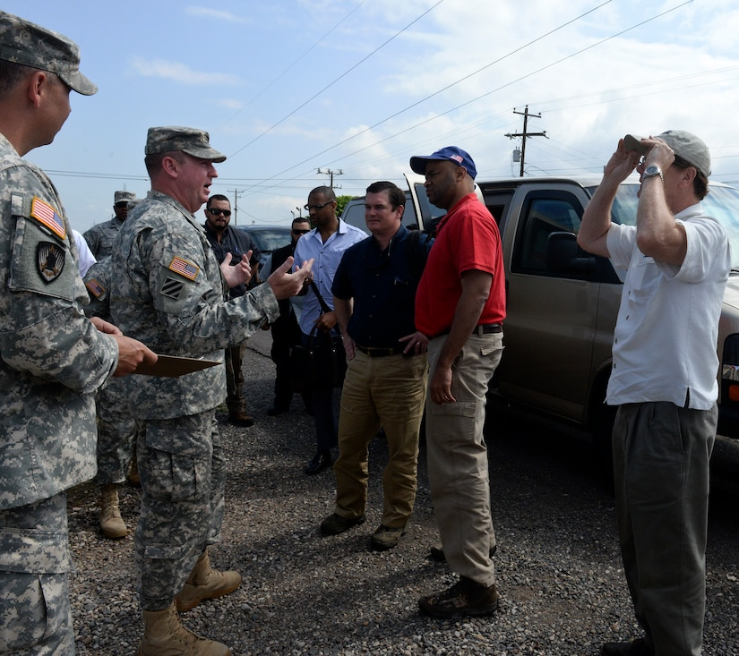 SOTO CANO AIR BASE, Honduras – U.S. Army Col. Kirk Dorr, Joint Task Force – Bravo commander, greets Ambassador James Nealon, U.S. Ambassador to Honduras (right), Congressman Marc Veasey (center right), representing Texas' 33rd District, and Congressman Austin Scott (center left), representing Georgia's 8th District,  during a congressional delegation tour May 4, 2015, at Soto Cano Air Base, Honduras. The delegation came to learn about JTF-B's support to the broader U.S. and partner nation stabilization efforts in Central America. (U.S. Air Force photo by Staff Sgt. Jessica Condit)