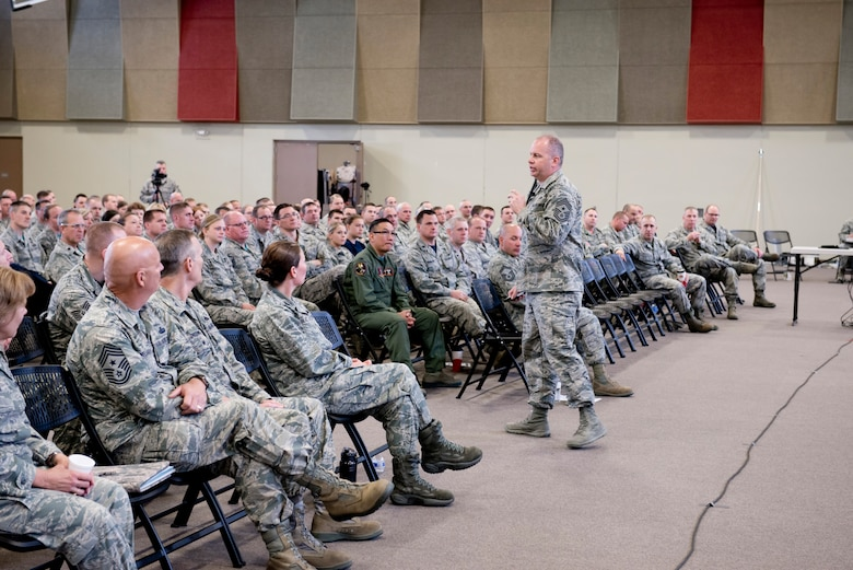 The Command Chief Master Sgt. of the Air National Guard (CCM ANG), Chief Master Sgt. James W. Hotaling speaks to members of the 132d Wing, Des Moines, Iowa during the May Off-Site Resiliency Event held at the Valley Community Center, West Des Moines, Iowa on Saturday, May 2, 2015.  The Director of the Air National Guard (DANG), Lt. Gen. Stanley E. Clarke III, is also in attendance, which marks the first time in history that both the DANG and CCM ANG visit an ANG wing together.  (U.S. Air National Guard photo by Tech. Sgt. Linda K. Burger/Released)