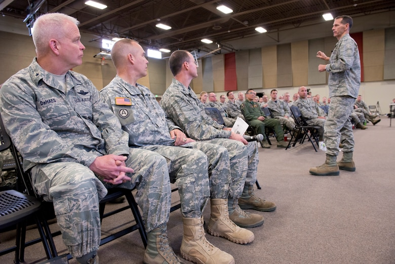 The Director of the Air National Guard (DANG), Lt. Gen. Stanley E. Clarke III (right) speaks to members of the 132d Wing (132WG), Des Moines, Iowa during the May Off-Site Resiliency Event held at the Valley Community Center, West Des Moines, Iowa on Saturday, May 2, 2015; Brig. Gen. Drew DeHaes (left), Deputy Adjutant General of the Iowa Air National Guard, Maj. Gen. Timothy Orr (second from left), The Adjutant General of the Iowa National Guard, and Col. Kevin Heer (second from right), Commander of the 132WG, listen to his message.  The Command Chief Master Sgt. of the Air National Guard (CCM ANG), Chief Master Sgt. James W. Hotaling, is also in attendance, which marks the first time in history that both the DANG and CCM ANG visit an ANG wing together.  (U.S. Air National Guard photo by Tech. Sgt. Linda K. Burger/Released)