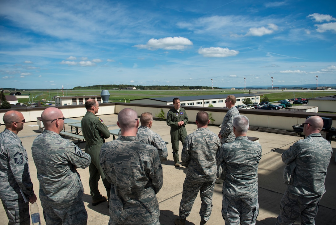 U.S. Air Force Lt. Col. Ryan Nudi, 52nd Fighter Wing chief of safety, center, addresses wing leadership before the group participated in a demonstration of the base's wildlife management programs at Spangdahlem Air Base, Germany, May 4, 2015. The programs include trapping, hunting, falconry and clearing of nests. (U.S. Air Force photo by Airman 1st Class Luke Kitterman/Released)