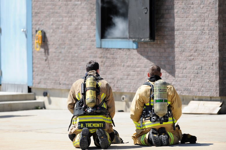 150501-Z-VA676-011 -- Firefighters from Selfridge Air National Guard Base participate in a series of exercises and drills while working at the fire training center operated by the Macomb Township Fire Department, just a few miles from the air base, May 1, 2015. Firefighters at Selfridge are required to be skilled in fighting potential structure fires as well as being able to respond to aircraft-related emergencies. The Selfridge Fire Department routinely interacts with a number of neighboring fire departments through a series of mutual aid agreements. (U.S. Air National Guard photo by Tech. Sgt. Dan Heaton)
