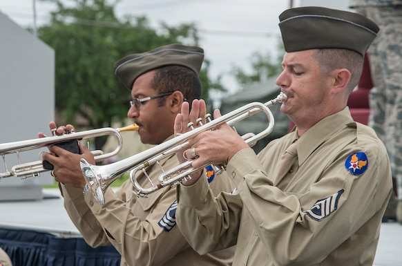 The U.S. Air Force Band of the West performs while wearing historic military uniforms during an unveiling ceremony for the Enlisted Tuskegee Airmen Exhibit May 4, 2015, at Joint Base San Antonio-Lackland's U.S. Air Force Airman Heritage Museum & Enlisted Character Development Center.  The unveiling ceremony honors the enlisted Tuskegee Airmen, a group of African-American military ground support Airmen who were part of the 332nd Fighter Group and the 477th Bombardment Group during World War II.  The exhibit, a three-dimensional recreation of a World War II combat operations room displaying an enlisted aircraft line mechanic, enlisted administrator and a Tuskegee fighter pilot, depicts the hard work, sacrifice and determination the Tuskegee Airmen put forth as members of the Army Air Corps to help America win World War II. (U.S. Air Force photo by Johnny Saldivar/released)