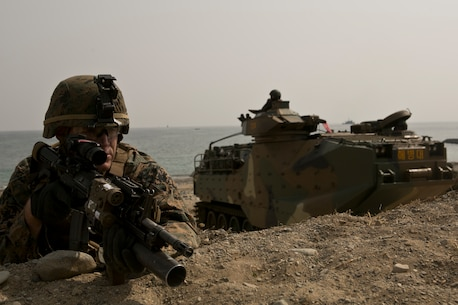 U.S. Marine Cops Cpl. Gary Johnston provides security during a beach landing exercise with Republic of Korea (ROK) Marines in the vicinity of Pohang, South Korea, March 29, 2015. The 31st Marine Expeditionary Unit (MEU) participated in  Korean Marine Exchange Program 15. The overall objective of KMEP 15 is to enhance amphibious operations between ROK and U.S. forces that contributes to security and stability on the Korean Peninsula as well as the entire Asia-Pacific region. Johnston is with Company G, Battalion Landing Team 2nd Battalion, 4th Marines, 31st MEU.