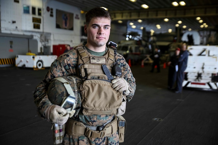 U.S. Marine Corps Cpl. Jeremiah Skaggs poses in the hangar bay of the USS Bonhomme Richard (LHD 6), at sea, March 16, 2015. Skaggs, from Stockton, California, has trained in multiple environments including Bridgeport, California, Twentynine Palms, California, Okinawa, Japan, and now aboard the USS Bonhomme Richard. Skaggs is a squad leader with Weapons Co., Battalion Landing Team 2nd Battalion, 4th Marines, 31st Marine Expeditionary Unit and is currently participating in the MEU's annually-scheduled Spring Patrol of the Asia-Pacific region. (U.S. Marine Corps photo by Lance Cpl. Ryan C. Mains/Released)