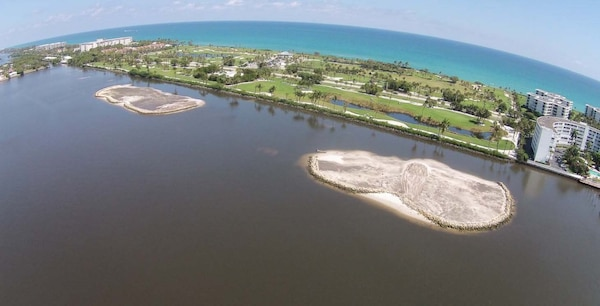 The completed Grassy Flats Restoration Project will restore more than 20 acres of critical estuary habitat in Lake Worth Lagoon and support over 195 species of fish and 89 species of birds.‎