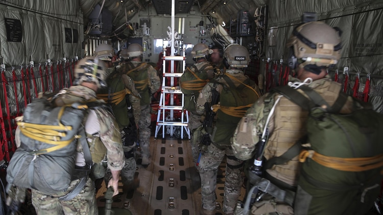 123rd Special Tactics Squadron personnel and Chilean Air Commandos load into a KC-130J Super Hercules from Marine Aerial Refueler Transport Squadron 252, to conduct a jump clearing team mission at Hurlburt Field, Florida, during Emerald Warrior 2015, April 28, 2015. The combined team had 20 jumpers and two 50cc mini bikes, which were dropped off at the landing zone prior to the jump.  Emerald Warrior is a joint exercise led by Air Force Special Operations Command that provides pre-deployment training for U.S. and partner nation special operations forces and interagency elements. (U.S. Marine Corps photo by Cpl. Alexander Mitchell/released)